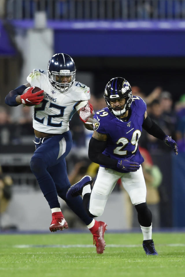 Tennessee Titans running back Derrick Henry (22) runs against Baltimore Ravens free safety Earl Thomas (29) during the first half an NFL divisional playoff football game, Saturday, Jan. 11, 2020, in Baltimore. (AP Photo/Gail Burton)