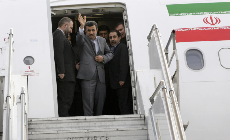 FILE - In this Thursday, March 7, 2013, file photo, Iranian President Mahmoud Ahmadinejad waves from his plane while leaving Mehrabad airport in Tehran, Iran, en route to Venezuela to attend Hugo Chavez's funeral ceremony. No one is really counting on outgoing President Mahmoud Ahmadinejad to fade away once the spotlight-hungry politician formally hands over the office in three weeks. What's ahead remains a murky mix of expected payback from his opponents and speculation on his next moves, ranging from media boss to freelance statesman. (AP Photo/Vahid Salemi, File)