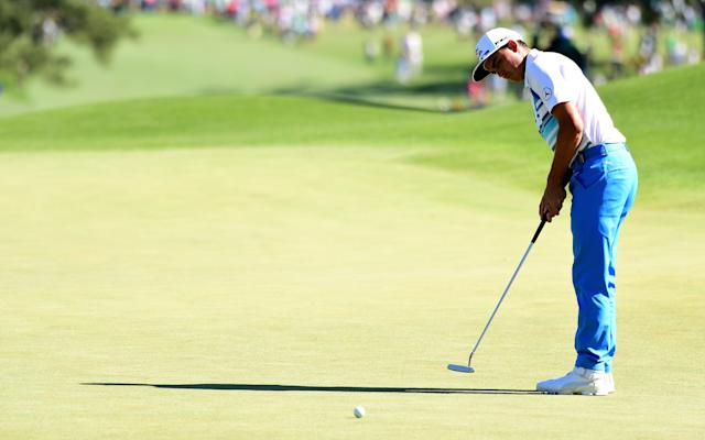 <span>Rickie Fowler knocks in another putt</span> <span>Credit: Harry How/Getty Images </span>