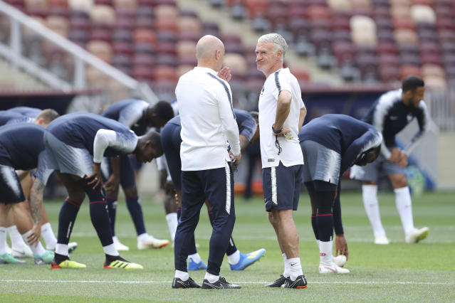 France headcoach Didier Deschamps, right, reacts during France's official training at the eve of the group C match between France and Denmark at the 2018 soccer World Cup in the Luzhniki Stadium in Moscow, Russia, Monday, June 25, 2018. (AP Photo/David Vincent)