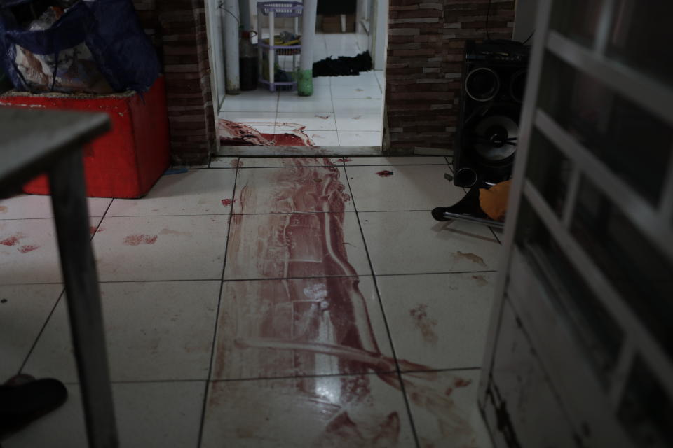 Blood covers the floor of a home during a police operation targeting drug traffickers in the Jacarezinho favela of Rio de Janeiro, Brazil, Thursday, May 6, 2021. At least 25 people died including one police officer and 24 suspects, according to the press office of Rio's civil police. (AP Photo/Silvia Izquierdo)