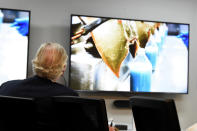 South Carolina Gov. Henry McMaster watches a video on the bleeding of horseshoe crabs, whose blood is a vital component in the contamination testing of injectable medicines - including the coronavirus vaccines - at Charles River Labs on Friday, Aug. 6, 2021, in Charleston, S.C. McMaster says a South Carolina company that bleeds horseshoe crabs for a component crucial to contamination testing of injectable medications is vital to development of a domestic medical supply chain.(AP Photo/Meg Kinnard)