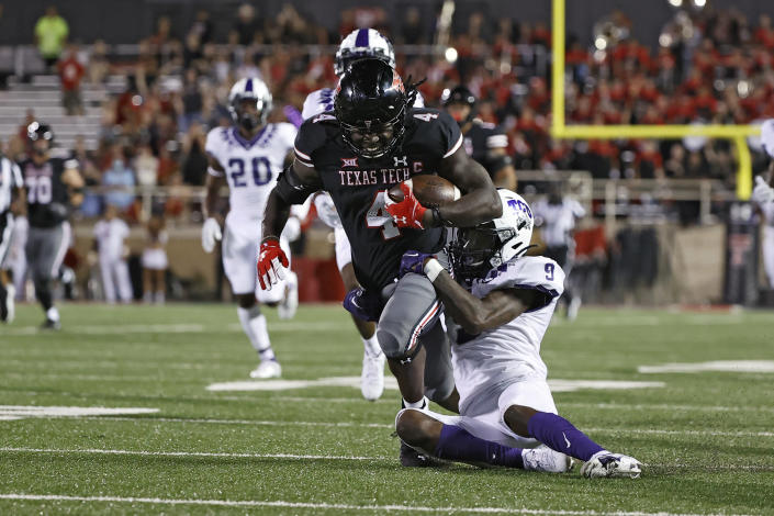 TCU's C.J. Ceasar II (9) tackles Texas Tech's SaRodorick Thompson (4) during the second half of an NCAA college football game Saturday, Oct. 9, 2021, in Lubbock, Texas. (AP Photo/Brad Tollefson)