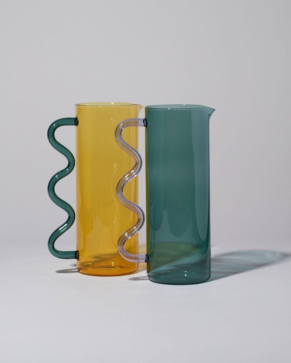 """<p><strong>Sophie Lou Jacobsen</strong></p><p>mociun.com</p><p><strong>$215.00</strong></p><p><a href=""""https://mociun.com/products/sophie-lou-jacobsen-wave-pitcher?variant=34756841308296"""" rel=""""nofollow noopener"""" target=""""_blank"""" data-ylk=""""slk:Shop Now"""" class=""""link rapid-noclick-resp"""">Shop Now</a></p><p>The Wave Pitcher by Sophie Lou Jacobsen is made of borosilicate glass, an especially hard to break material that is durable and sustainable. For pouring juice, watering plants, holding flowers, or just looking fine on a mantle—these forever pieces are inherently eco because there's no way anyone is getting rid of these. </p>"""