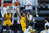 Maryland guard Aaron Wiggins (2) shoots over Michigan guard Chaundee Brown (15) in the first half of an NCAA college basketball game at the Big Ten Conference tournament in Indianapolis, Friday, March 12, 2021. (AP Photo/Michael Conroy)