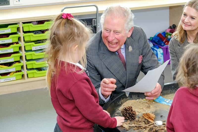 The Prince of Wales greets school children as he attends a reception in Newquay, Cornwall, to celebrate the 30th anniversary of Surfers Against Sewage and officially opens the Nansledan development school.