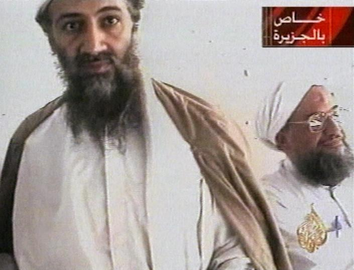 """FILE - This undated image taken from video released by Qatar's Al-Jazeera televison broadcast Oct. 5, 2001, purports to show al-Qaida leader Osama bin Laden, left, and his top lieutenant, Egyptian Ayman al-Zawahiri. U.S. attempts to deliver a """"knockout punch"""" to al-Qaida has been hamstrung by a breakdown in relations between the U.S. and Pakistan over the raid to get bin Laden. Now Al-Qaida leader Al-Zawahri is thought to be hiding in the Pakistani mountains. (AP Photo/Courtesy of Al-Jazeera via APTN)"""