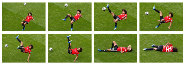 """Soccer Football - World Cup - Group A - Egypt vs Uruguay - Ekaterinburg Arena, Yekaterinburg, Russia - June 15, 2018 A combination picture shows Egypt's Amr Warda attempting an overhead kick. Darren Staples: """"My favourite shot of the World cup was of Egypt's Amr Warda during their match against Uruguay in Ekaterinburg. I was shooting from the tribune, a rare experience for myself. It's a position photographers are not permitted to shoot from during English Premier League games - the nice dry bit where the writers sit. I find it interesting because not only does it only give you more scope to play with the shadows from the stadium, but it also gives you a better understanding of the teamÕs formations and tactics when looking from above. I was always told you shouldnÕt laugh at others' misfortunes, but on this occasion I couldnÕt stop myself. Warda attempted an overhead kick, a photographer's dream shot when the ball nestles in the back of the net. This time though, the player completely missed the ball and landed flat on his back in front of 35,000 people. I felt his embarrassment."""" REUTERS/Darren Staples/File Photo SEARCH """"PHOTOGRAPHERS BEST"""" FOR THIS STORY. SEARCH """"WIDER IMAGE"""" FOR ALL STORIES. TPX IMAGES OF THE DAY."""