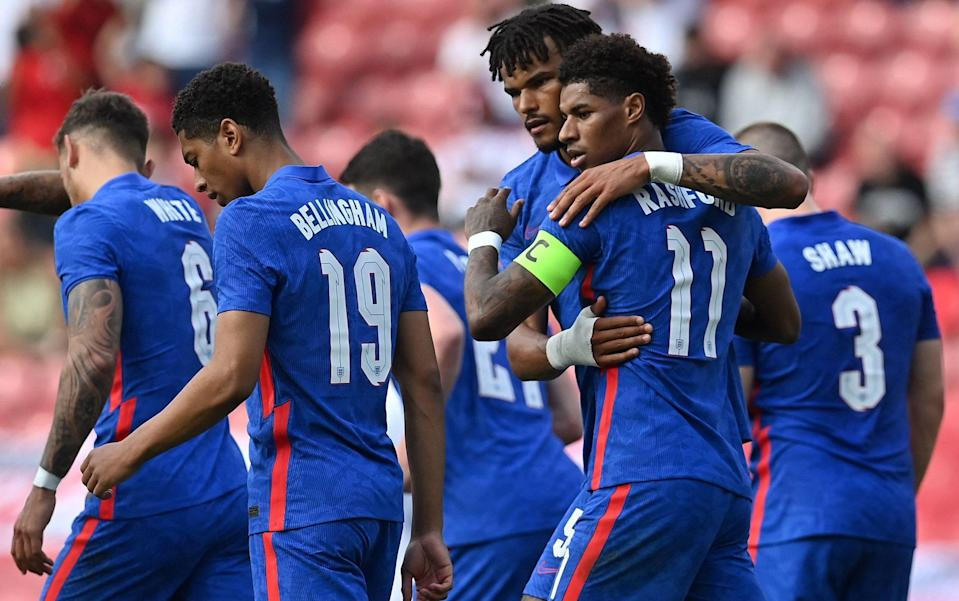 England's striker Marcus Rashford (2R) celebrates scoring his team's first goal with England's defender Tyrone Mings (3R) during the international friendly football match between England and Romania at the Riverside Stadium in Middlesbrough, north-east England on June 6, - GETTY IMAGES