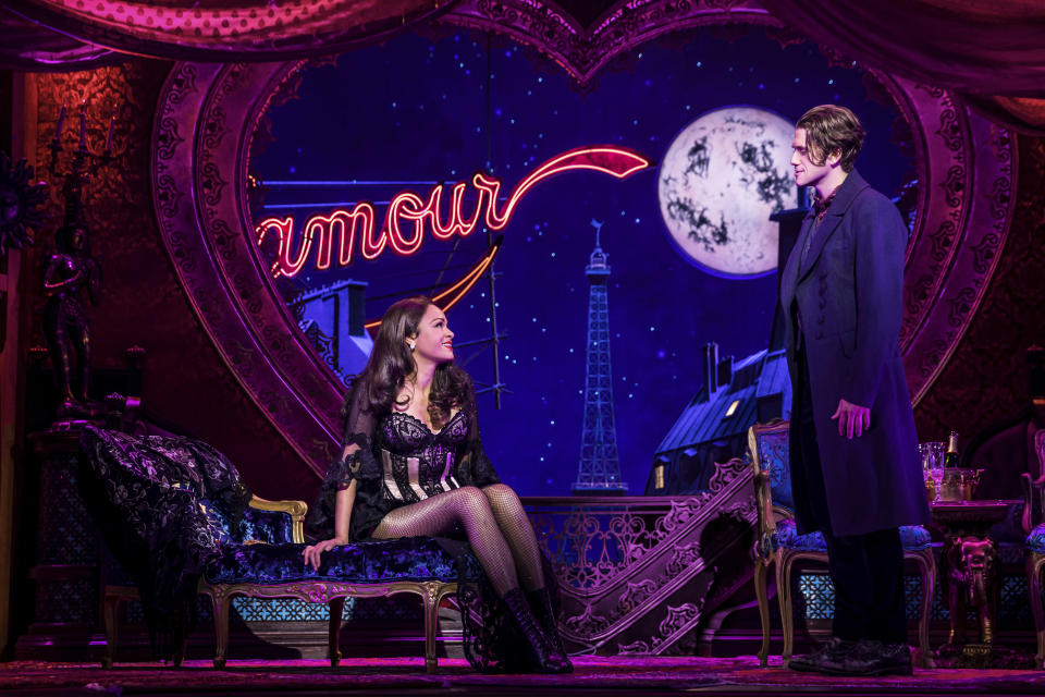 """Aaron Tveit, right, appears with Karen Olivo during a performance of """"Moulin Rouge! The Musical,"""" in New York. Tveit was the only actor nominated for a Tony in the category of best leading actor in a musical for his role. (Matthew Murphy/Boneau/Bryan-Brown via AP)"""