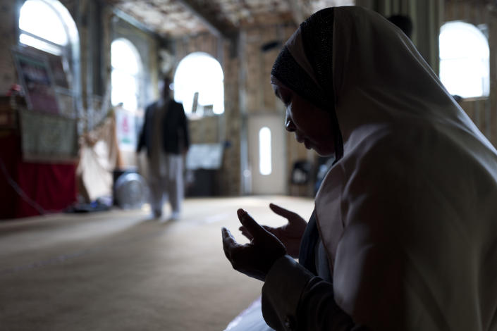 FILE - In this Sept. 7, 2017 file photo, Tahirah Clark, an attorney for the Muslim enclave of Islamberg in Delaware County, N.Y., prays in the community's mosque. The enclave near the Catskill Mountains is dogged by terror accusations, many made on right-wing websites. Though police and analysts dismiss those accusations, they have persisted from the time the enclave was settled in the 1980s. (AP Photo/Mark Lennihan)