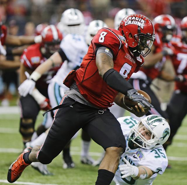 Louisiana-Lafayette quarterback Terrance Broadway (8) gets around Tulane safety Sam Scofield (35) during the second half of the New Orleans Bowl NCAA college football game, Saturday, Dec. 21, 2013, in New Orleans. (AP Photo/Bill Haber)