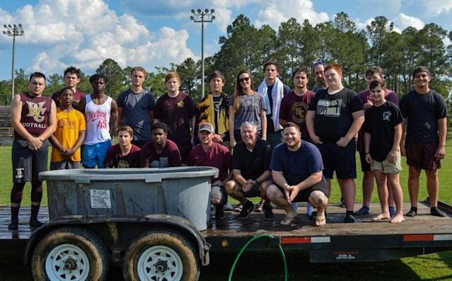 The Washington County High School Football team poses after their team baptism in Chatom, Ala. (Credit: Washington County High School Football team/Facebook)
