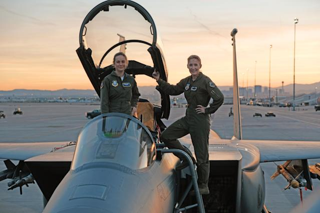 Brie Larson, left, gets hands-on help from Brig. Gen. Jeannie Leavitt, 57th Wing Commander, on a recent trip to Nellis Air Force Base in Nevada to research her character, Carol Danvers, aka Captain Marvel, for Marvel Studios' <em>Captain Marvel</em>. (Photo: Brad Baruh/Marvel Studios)