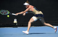 A line camera films as Marketa Vondrousova of the Czech Republic makes a backhand return during her second round match against Canada's Rebecca Marino at the Australian Open tennis championship in Melbourne, Australia, Wednesday, Feb. 10, 2021. Eliminating all line judges and removing the human element from officiating at the Australian Open might have been a necessary step to reduce the number of people on court amid a pandemic. It also might be good for the integrity of the game, because getting every call right matters so much to players and fans. (AP Photo/Andy Brownbill)