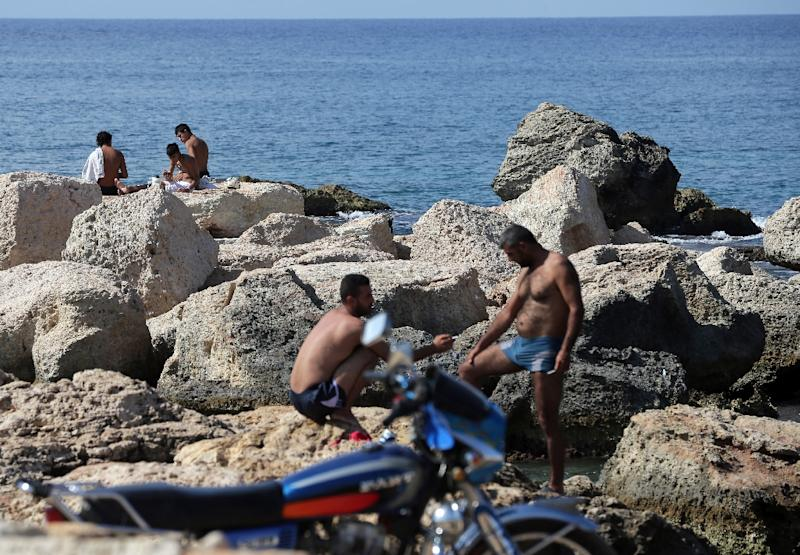 People by the sea in Latakia on September 24, 2015, on the first day of the Muslim holiday of Eid al-Adha (AFP Photo/Joseph Eid)