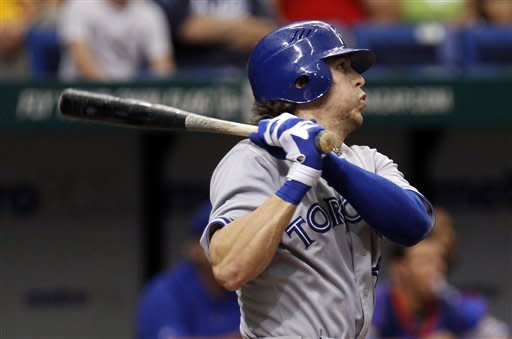 Toronto Blue Jays' Colby Rasmus follows the flight of his seventh-inning triple off Tampa Bay Rays starting pitcher James Shields during a baseball game, Wednesday, May 23, 2012, in St. Petersburg, Fla. (AP Photo/Chris O'Meara)
