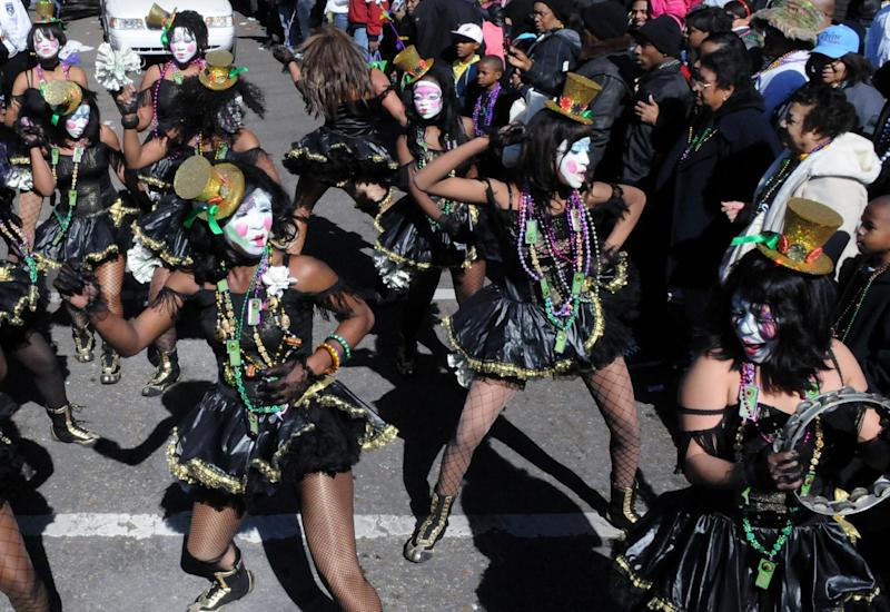 This 2010 photo provided by Jeffry Dupuis shows the Baby Doll Ladies performing in the Zulu krewe parade on Mardi Gras in New Orleans. Baby dolls – groups of women in skimpy or short, ruffled dresses – started with one group of African-American prostitutes wanting to one-up another on Mardi Gras 1912, but spread within decades to respectable black neighborhoods. The tradition had died out is seeing a modern revival. (AP Photo/Courtesy Jeffry Dupuis via New Orleans Society of Dance)