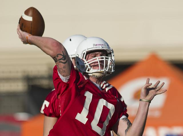 In this March 7, 2014 photo, Tennessee quarterback Riley Ferguson throws a pass during an NCAA college spring practice in Knoxville, Tenn. Tennessee coach Butch Jones is still waiting for someone to separate themselves from the rest in the Volunteers' four-man quarterback competition as spring practice draws to a close. (AP Photo/The Knoxville News Sentinel, Paul Efird)