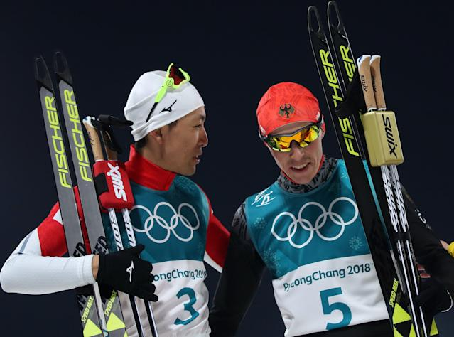 Nordic Combined Events – Pyeongchang 2018 Winter Olympics – Men's Individual 10km Final – Alpensia Cross-Country Skiing Centre - Pyeongchang, South Korea – February 14, 2018 - Akito Watabe of Japan and Eric Frenzel of Germany after the finish line. REUTERS/Carlos Barria