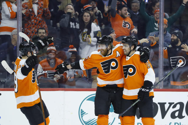 Philadelphia Flyers' Jakub Voracek, center, celebrates with Matt Niskanen, right, and Joel Farabee after scoring a goal during the second period of an NHL hockey game against the Pittsburgh Penguins, Tuesday, Jan. 21, 2020, in Philadelphia. (AP Photo/Matt Slocum)