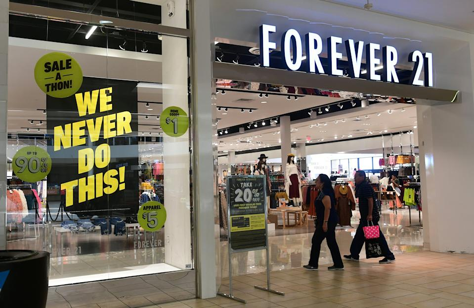 People enter a Forever 21 store at a shopping mall in Montebello, California on September 30, 2019 a day after the fashion retailer filed for Chapter 11 bankruptcy protection. - Global fast-fashion retailer Forever 21 said it was filing for voluntary bankruptcy Sunday, the latest US brick-and-mortar chain to embark on restructuring as shoppers migrate online. (Photo by Frederic J. BROWN / AFP)        (Photo credit should read FREDERIC J. BROWN/AFP/Getty Images)