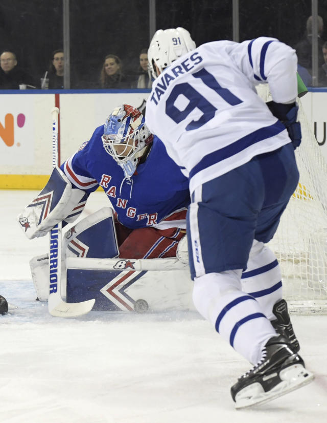 New York Rangers goaltender Alexandar Georgiev (40) makes a save on a shot by Toronto Maple Leafs center John Tavares (91) during the first period of an NHL hockey game Sunday, Feb. 10, 2019, at Madison Square Garden in New York. (AP Photo/ Bill Kostroun)