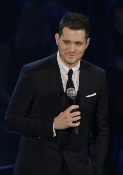 """FILE - In this Nov. 26, 2012 file photo, Canadian singer Michael Buble' performs during the Italian State RAI TV program """"Che Tempo che Fa"""", in Milan, Italy. Most of Buble's albums have reached multiplatinum status and his last three releases have hit No. 1 on the Billboard 200 albums chart, including 2011's triple platinum """"Christmas."""" His new album, """"To Be Loved,"""" will be released April 23 and includes a tribute to his wife, Argentine TV actress Luisana Lopilato. (AP Photo/Luca Bruno, File)"""
