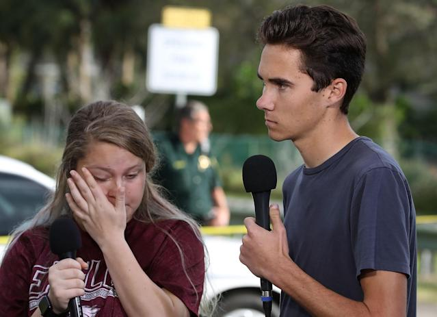 Students Kelsey Friend, left, and David Hogg recount their stories about Wednesday's mass shooting at the Marjory Stoneman Douglas High School. (Photo: Mark Wilson/Getty Images)
