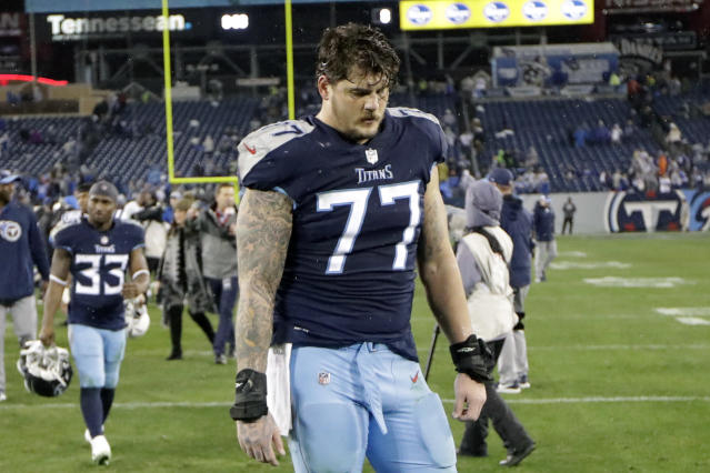 FILE - In this Dec. 30, 2018, file photo, Tennessee Titans offensive tackle Taylor Lewan (77) leaves the field after an NFL football game against the Indianapolis Colts, in Nashville, Tenn. Lewan, Tennessees three-time Pro Bowl left tackle, says the NFL has suspended him for the first four games of the season for violating the leagues policy on performance-enhancing drugs. Lewan announced his suspension Wednesday, July 24, 2019, in a video he posted to Twitter. (AP Photo/James Kenney, File)