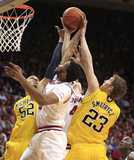 Indiana's Christian Watford, middle, vies with Michigan's Jordan Morgan, left, and Evan Smotrycz for a rebound during the first half of an NCAA college basketball game Thursday, Jan. 5, 2012, in Bloomington, Ind. (AP Photo/Darron Cummings)