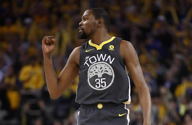 Kevin Durant weighed in with a 30-point game as the Warriors powered to a 116-101 win that puts the NBA champions 2-0 up in their best-of-seven series against the Spurs (AFP Photo/EZRA SHAW)