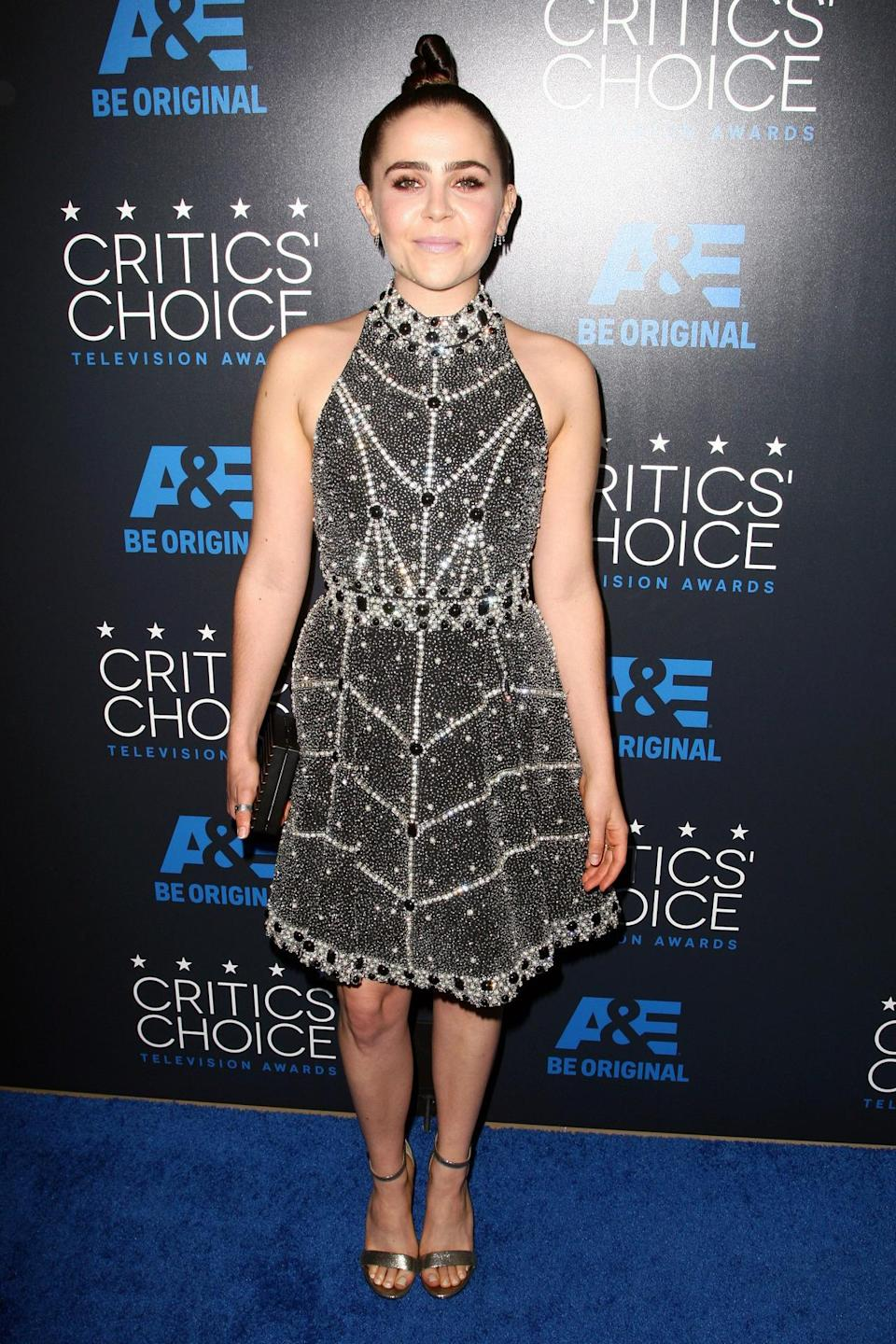 "Mae Whitman, who was nominated for best supporting actress in a drama series for her role on ""Parenthood,"" might not have taken home the prize (the award went to Lorraine Toussaint for ""Orange Is the New Black"") but her look certainly deserves accolades. The top knot is too cool and the mini dress, which is completely covered in pearls and beads, is elaborately awesome."