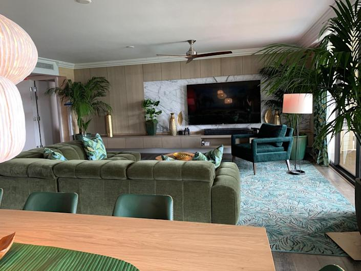 The green velvet Natuzzi sectional in the Palm Suite living room is from the Hawaiian store HomeWorld.
