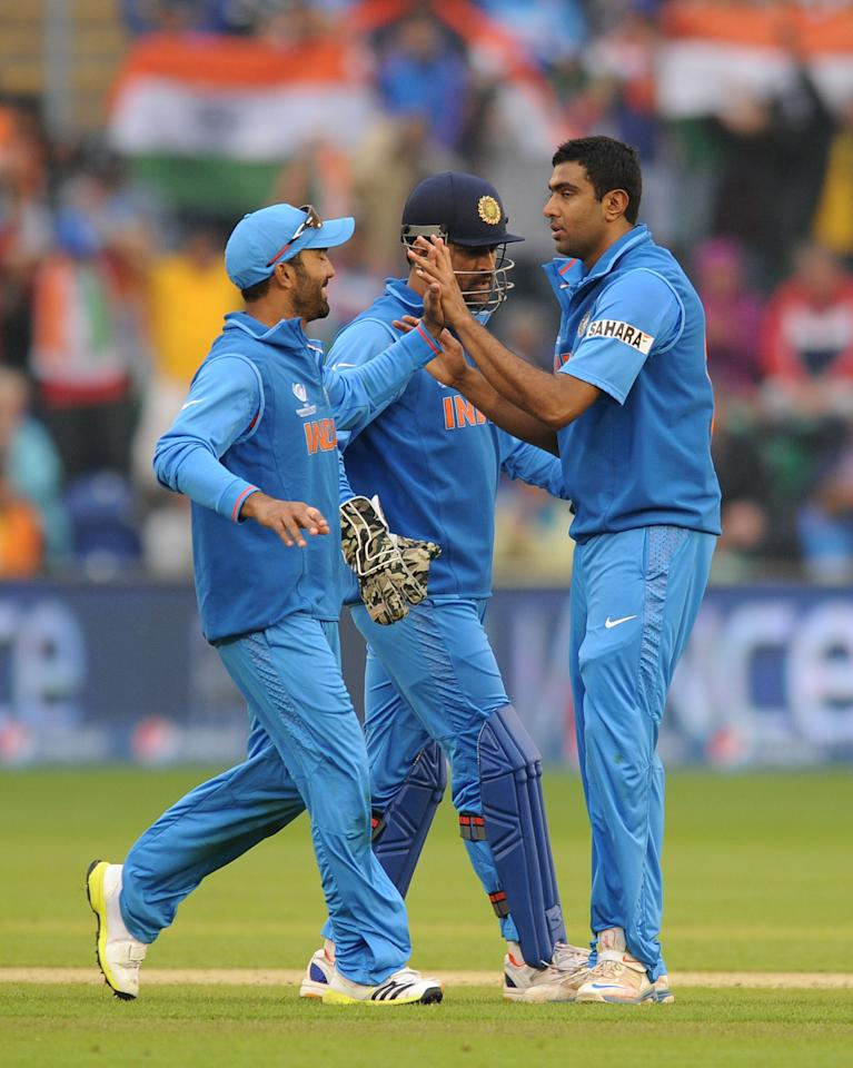 India's Ravichandran Ashwin (right) celebrates with his team mates after taking the wicket of Sri Lanka's Angelo Mathews (not pictured) during the ICC Champions Trophy, Semi Final at the SWALEC Stadium, Cardiff.