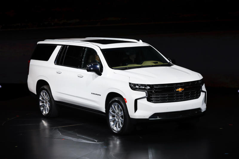 The 2021 Chevrolet Suburban Premier is unveiled in Detroit, Tuesday, Dec. 10, 2019. Global concerns about climate change are not stopping General Motors from making hulking SUVs for U.S. drivers. GM on Tuesday rolled out the next generation of its big truck-based SUVs with more space and features. (AP Photo/Paul Sancya)