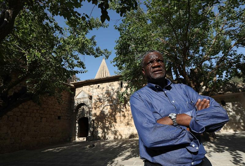 In June, Congolese gynaecologist Denis Mukwege visited Iraq's Yazidis community which had thousands of its women and girls kidnapped as sex slaves by IS militants in 2014 (AFP Photo/SAFIN HAMED)