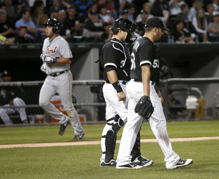 Chicago White Sox starting pitcher Hector Santiago, right, returns to the mound with catcher Josh Phegley after giving up a home run to Detroit Tigers' Jhonny Peralta, left, during the sixth inning of a baseball game Tuesday, July 23, 2013, in Chicago. (AP Photo/Charles Rex Arbogast)