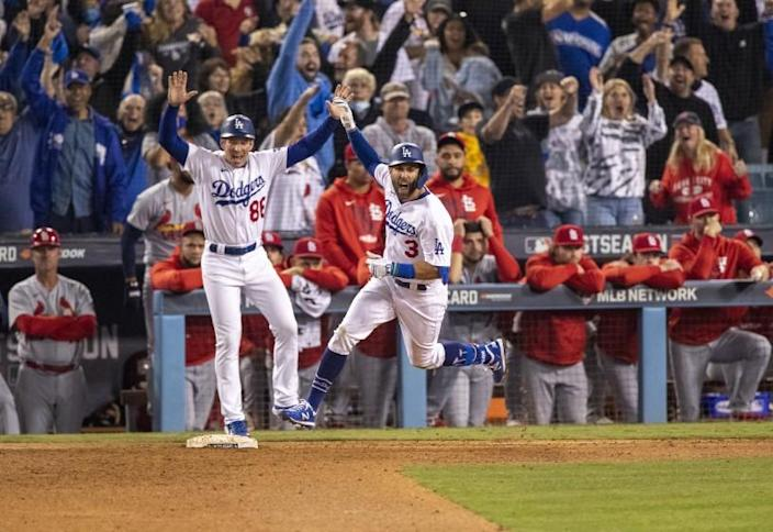 LOS ANGELES, CA - OCTOBER 6, 2021: Los Angeles Dodgers left fielder Chris Taylor (3) reacts while running the bases after his 2-run homer wins the game against the St Louis Cardinals in the National League Wild Card game at Dodger Stadium on October 6, 2021 in Los Angeles, California.(Gina Ferazzi / Los Angeles Times)