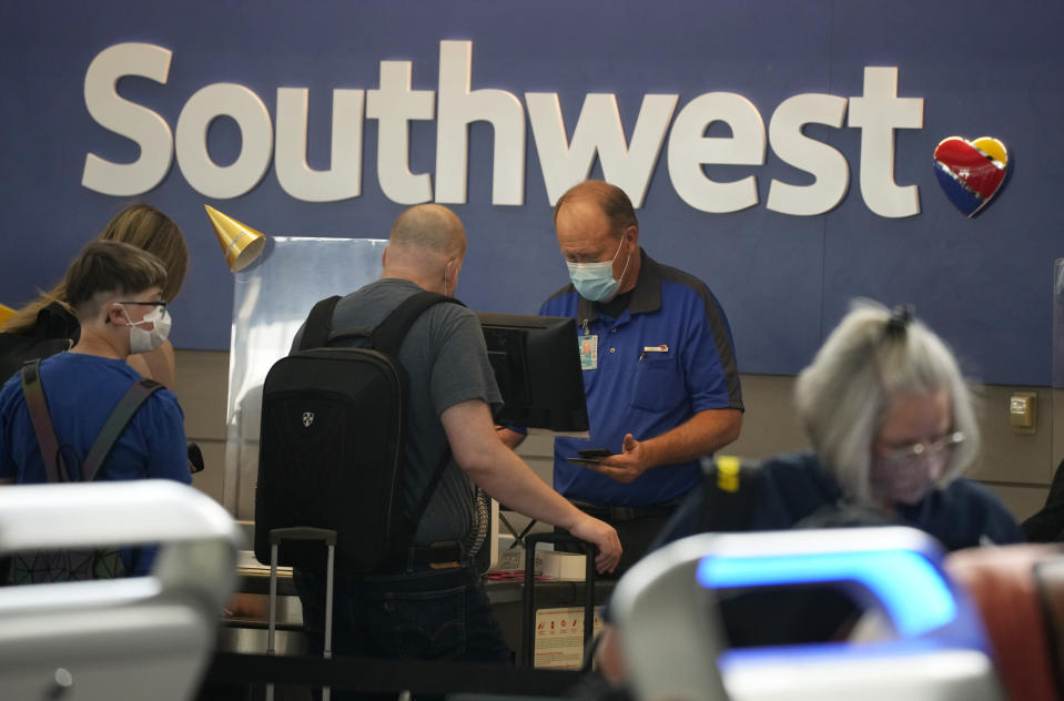 FILE - In this Wednesday, June 16, 2021, file photo, Southwest Airlines ticketing agent helps a traveller at the check-in counter at Denver International Airport in Denver. Sen. Maria Cantwell, D-Wash., who chairs the Senate Commerce Committee, sent letters Friday, July 16, 2021, to the CEOs of American, Southwest, Delta, JetBlue, Republic and Allegiant. She wrote that she is concerned by reports that have highlighted the role of worker shortages in a surge of delayed and canceled flights. (AP Photo/David Zalubowski, File)