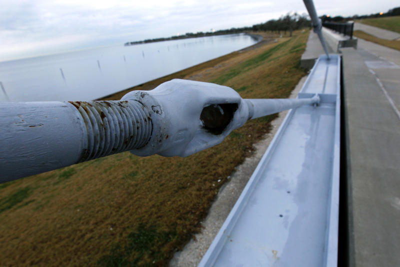 This Nov. 26, 2012, photo shows a flood wall and floodgate along Lakeshore Drive and Lake Pontchartrain in New Orleans. By the time the next hurricane season starts in June 2013, New Orleans will take control of much of a revamped protection system of gates, walls and armored levees the Army Corps of Engineers has spent about $12 billion building. The corps has about $1 billion worth of work left. Engineers consider it a Rolls Royce of flood protection, comparable to systems in seaside European cities such as Venice and Rotterdam. (AP Photo/Gerald Herbert)