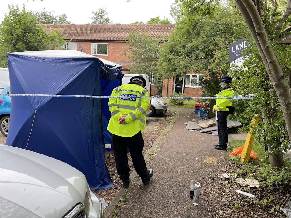 Police at the scene in Denmead, Two Mile Ash, in Milton Keynes, where a man has died after police fired gun shots at a property and where a second man was found dead and a young child seriously injured. Thames Valley Police (TVP) said in a statement officers were called to an address in Denmead, Two Mile Ash, at about 9.40am on Saturday and made a forced entry after acting on information from a witness. Picture date: Sunday June 27, 2021.