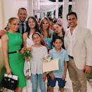 """Alex Rodriguez's oldest daughter says goodbye to middle school and hello to high school! The proud father gushed over his little girl on Instagram, following her middle school graduation. """"How is my beautiful angel going to be a freshman in high school?! Congrats Tashi, we love you! 👩🏽🎓❤️,"""" Rodriguez captioned his photo, which shows himself alongside fiancée Jennifer Lopez, ex-wife Cynthia Scurtis and both of their families."""