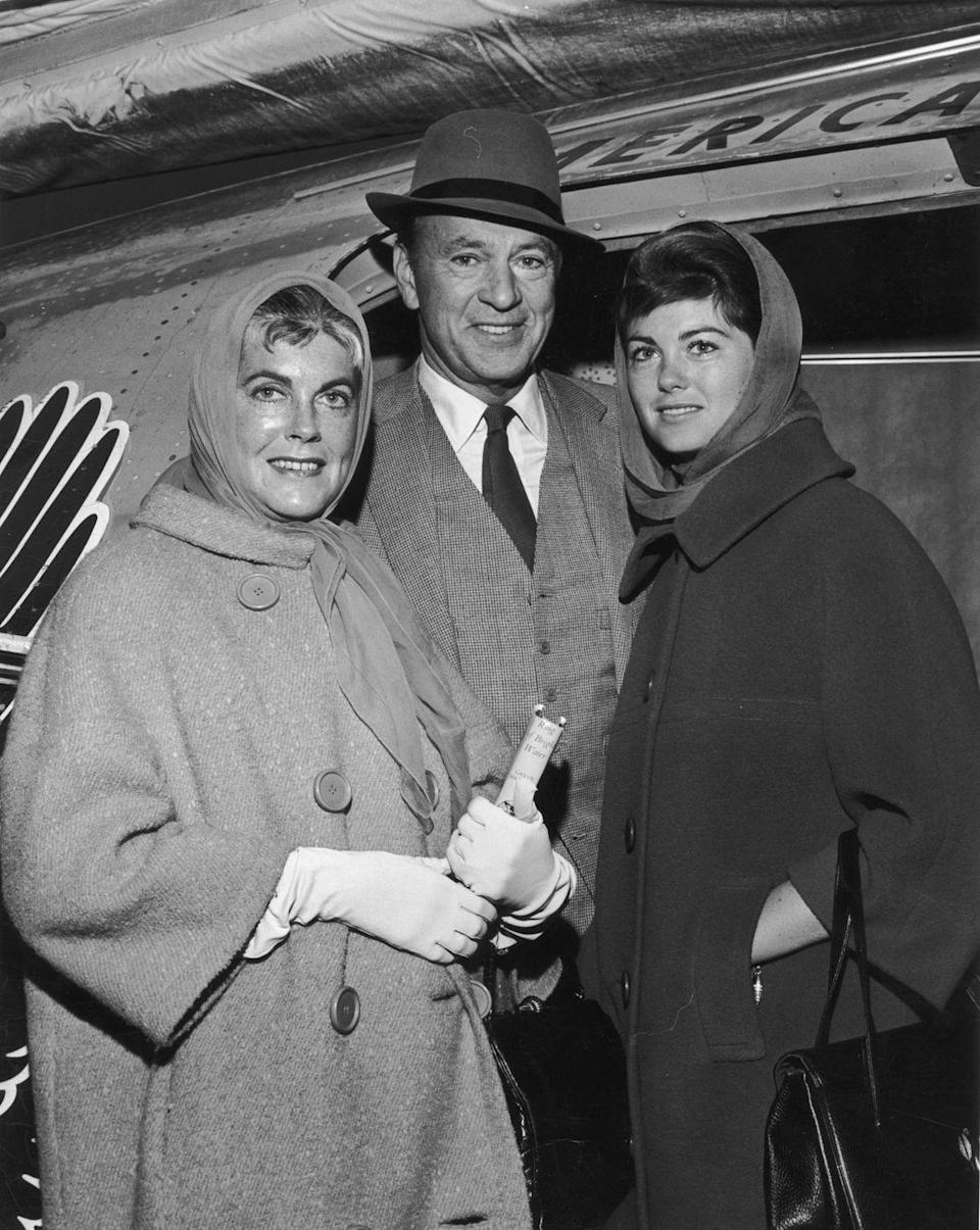 <p>Actor Gary Cooper smiles with his wife Sandra Shaw and his daughter Maria, as they prepare to board a flight to Los Angeles after a vacation in West Palm Beach, Florida. <br></p><p>Other celebrity visitors this year: Marilyn Monroe, Joe DiMaggio.</p>