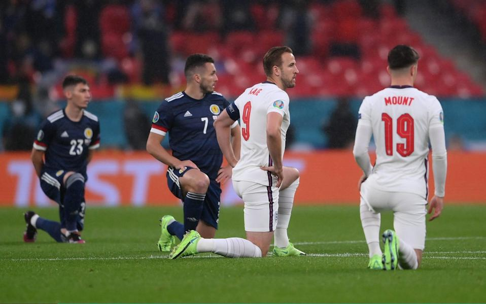 Harry Kane of England takes a knee in support of the Black Lives Matter movement prior to the UEFA Euro 2020 Championship Group D - Laurence Griffiths/Getty Images