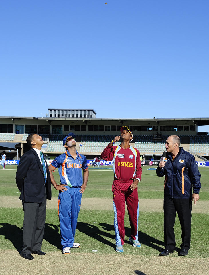 TOWNSVILLE, AUSTRALIA - AUGUST 12:  Kraigg Braithwaite of the West Indies tosses the coin while Unmukt Chand of India looks before the start of the ICC U19 Cricket World Cup 2012 match between the West Indies and India at Tony Ireland Stadium on August 12, 2012 in Townsville, Australia.  (Photo by Ian Hitchcock-ICC/Getty Images)