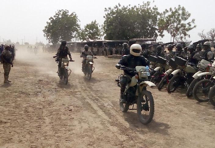 Nigerian soldiers ride new motorcycles introduced to provide security along highways reopened in the northeast state of Borno, nearly three years after they were shut because of Boko Haram attacks (AFP Photo/)