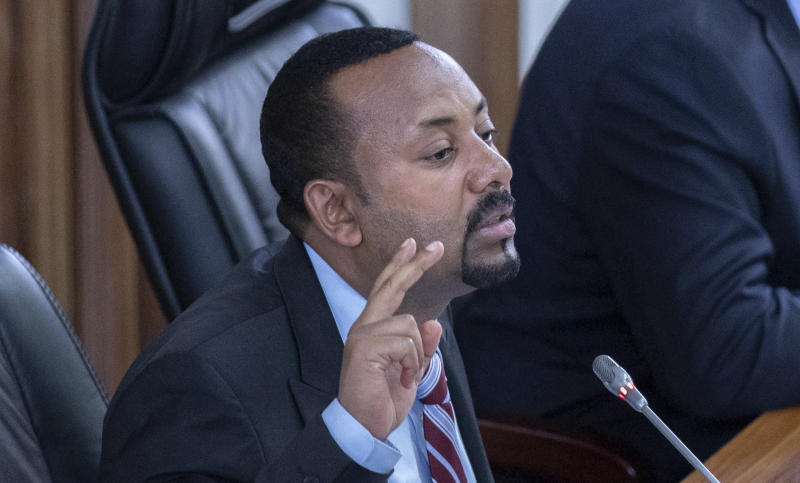 Ethiopian Prime Minister Abiy Ahmed addressing members of parliament on the current situation in the country inside the Parliament buildings, in Addis Ababa, Ethiopia, Tuesday Oct. 22, 2019. Ethiopia's Nobel Peace Prize-winning prime minister is warning that if there's a need to go to war over a dam project disputed with Egypt his country could ready millions of people, but he says only negotiation can resolve the deadlock. (AP photo Mulugeta Ayene)