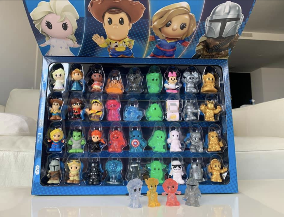 A full collection of Woolworths Ooshies collection in a display case.
