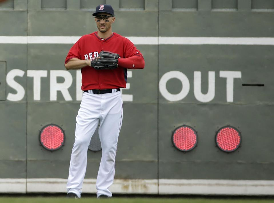 Boston Red Sox center fielder Grady Sizemore stands near the scoreboard in the outfield during the second inning of an exhibition baseball game against Northeastern, Thursday, Feb. 27, 2014, in Fort Myers, Fla. Sizemore returned to action for the first time in more than two years, playing three innings in left field and going hitless in two at-bats Thursday for the Red Sox in a 5-2 victory. (AP Photo/Steven Senne)